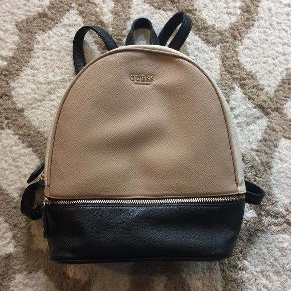 Guess Handbags - Guess Tan  black medium backpack priced to sell! 5ec92c457b8e1